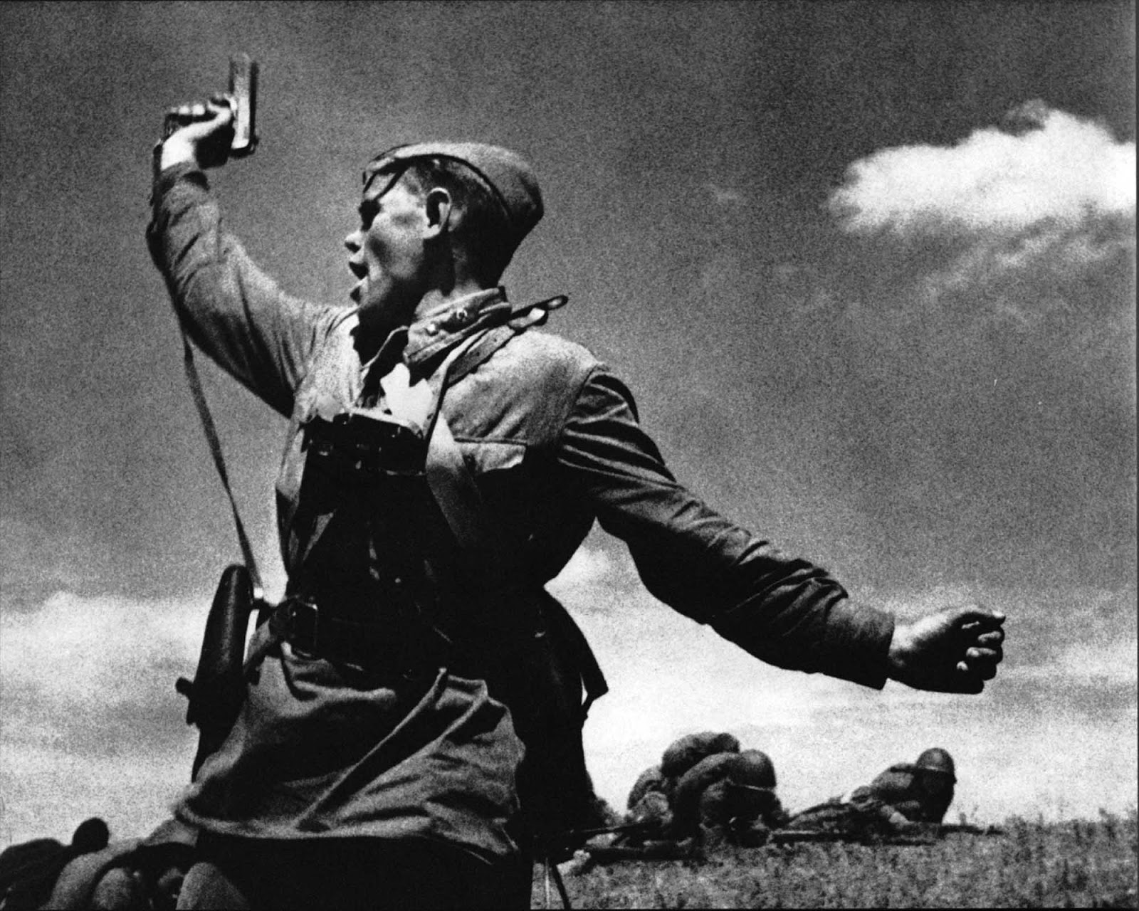 Political commissar Alexey Yeremenko leads his men into combat, he was killed minutes after this photo was taken, 1942